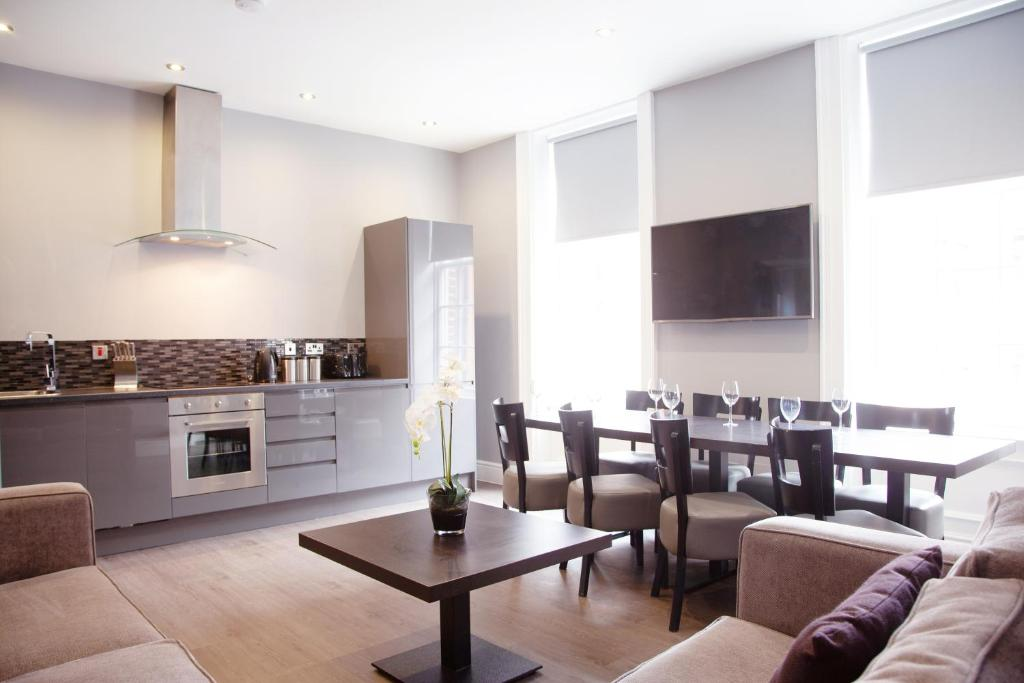 A kitchen or kitchenette at EPIC Apart Hotel- Campbell Street