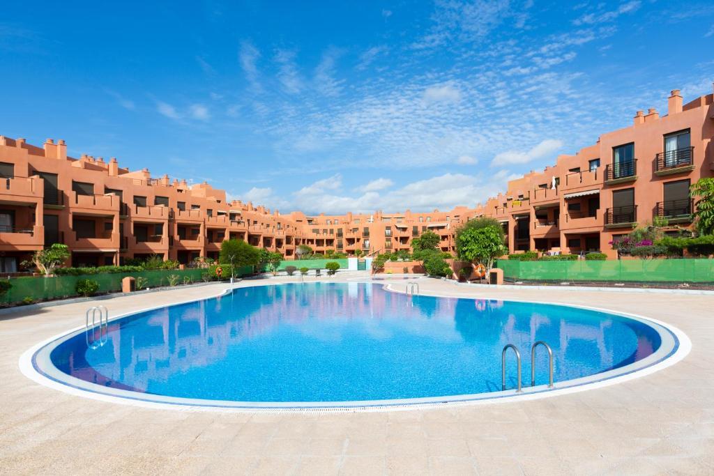 The swimming pool at or near Playa Tejita III NomaHolidays by Bossh! Apartments