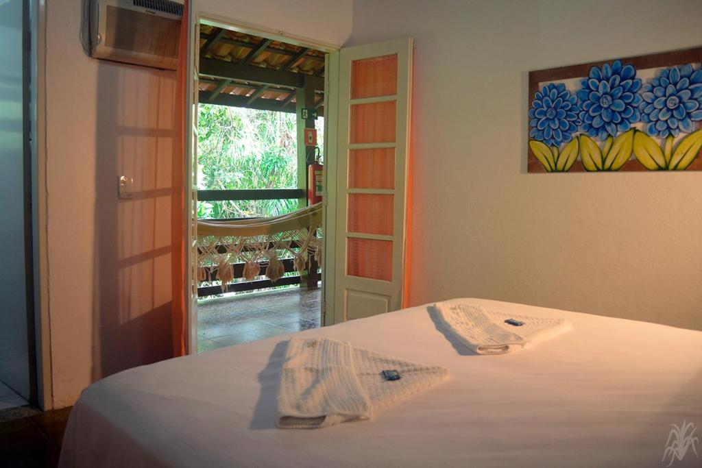 Cama ou camas em um quarto em Pousada Capim Melado