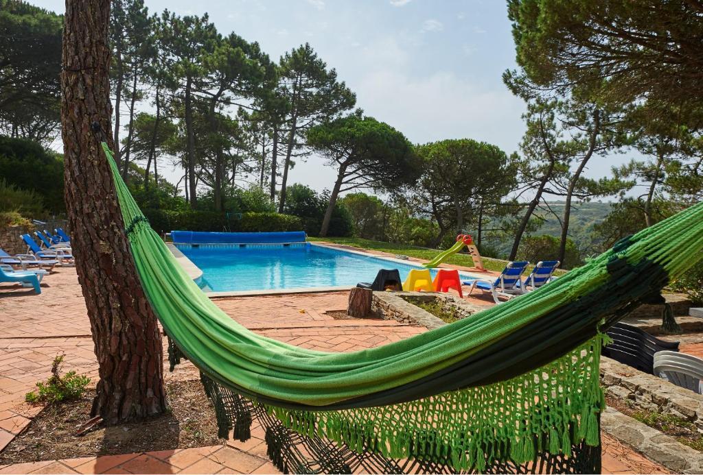 The swimming pool at or near Magoito's Villa