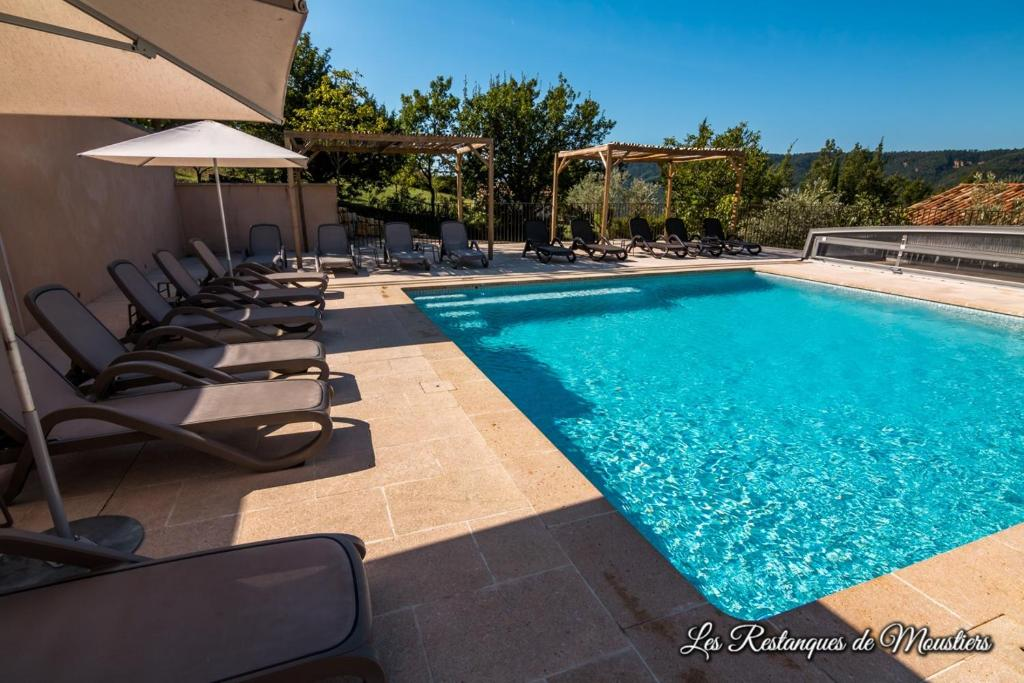 The swimming pool at or near Hotel Les Restanques De Moustiers
