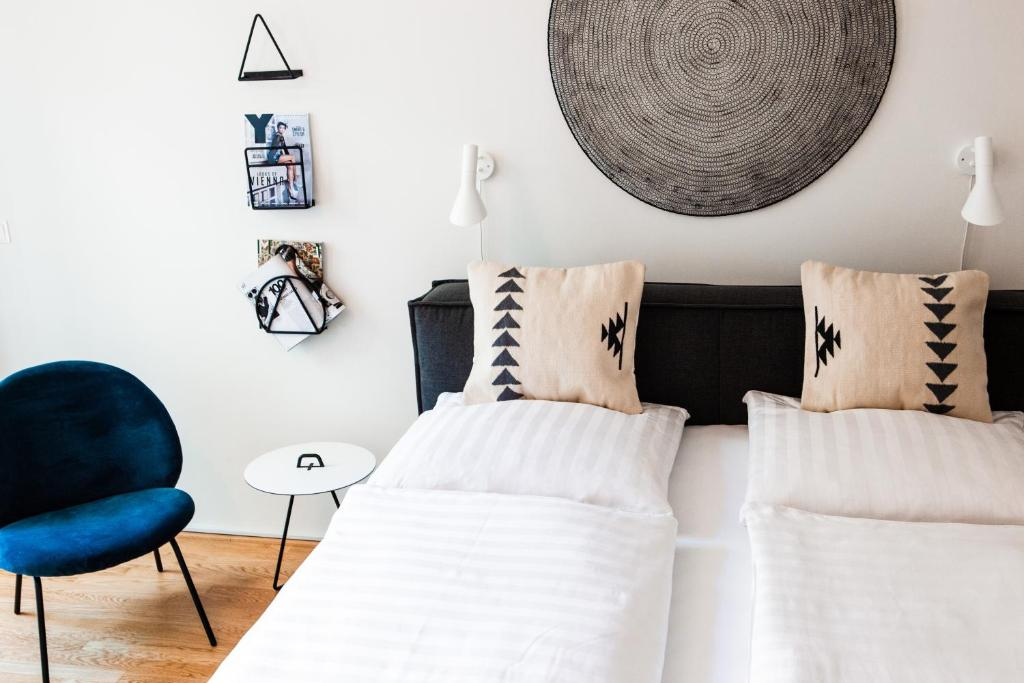 Ein Bett oder Betten in einem Zimmer der Unterkunft The BL42 - Vienna Concept Apartments
