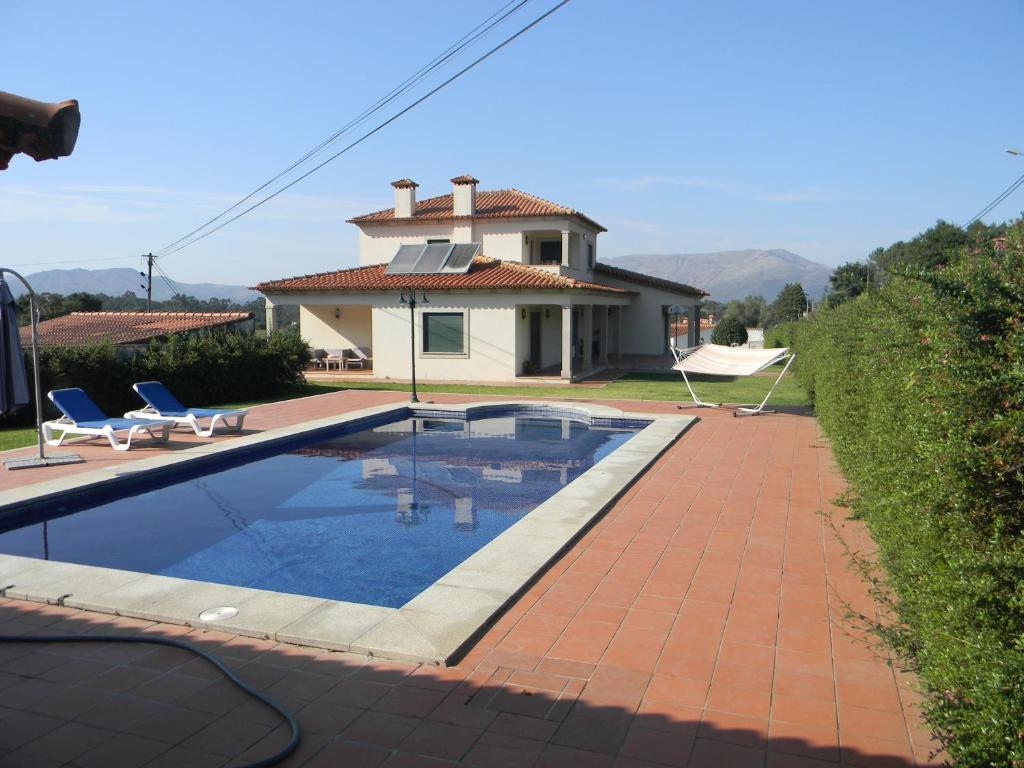 The swimming pool at or near Casa Estrada da Guia
