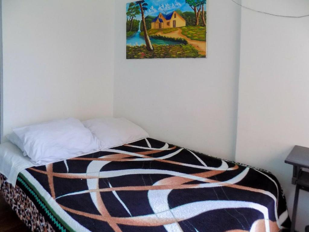 A bed or beds in a room at Hostal Donde Lili