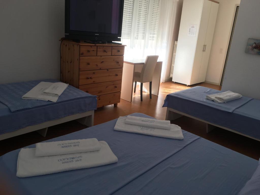 Ein Bett oder Betten in einem Zimmer der Unterkunft Hotel San Giobbe