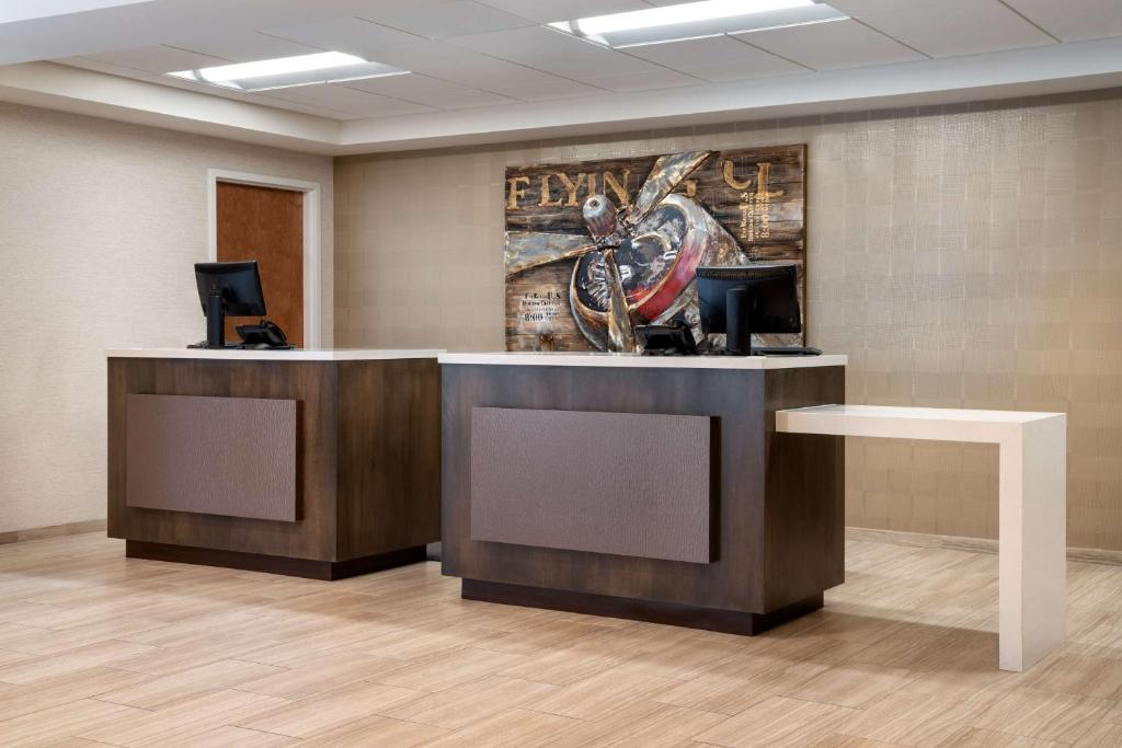 The lobby or reception area at Days Inn & Suites by Wyndham Denver International Airport
