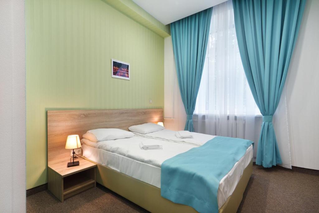 Кровать или кровати в номере Сити Стар