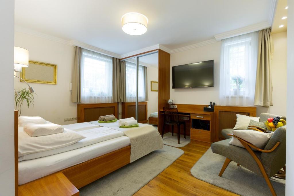 TV a/nebo společenská místnost v ubytování CityPark Villa Flat