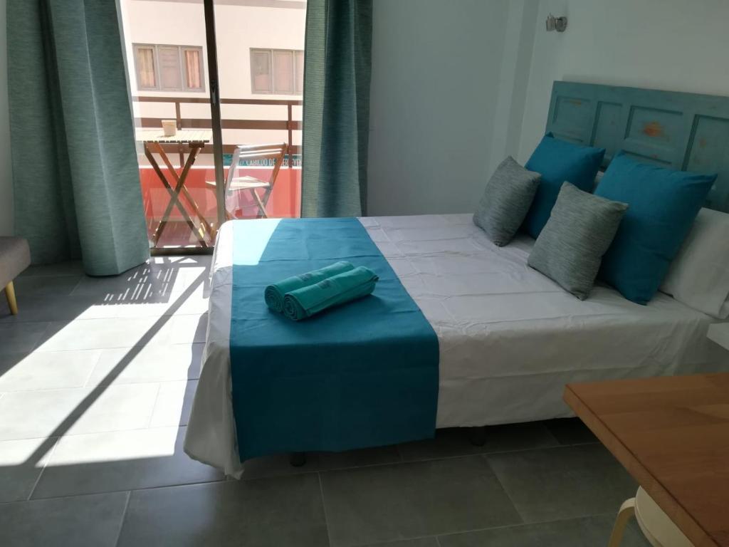 Cama o camas de una habitación en PLAYA DE JOROS Apartamentos Morro Jable