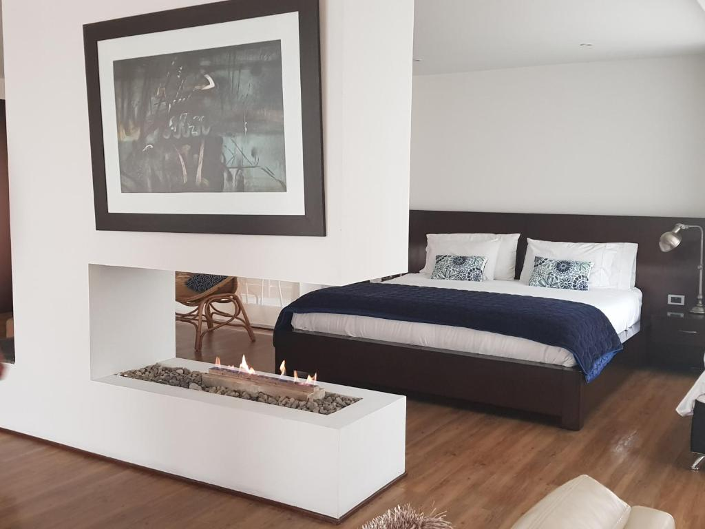 A bed or beds in a room at Suites Casa 95
