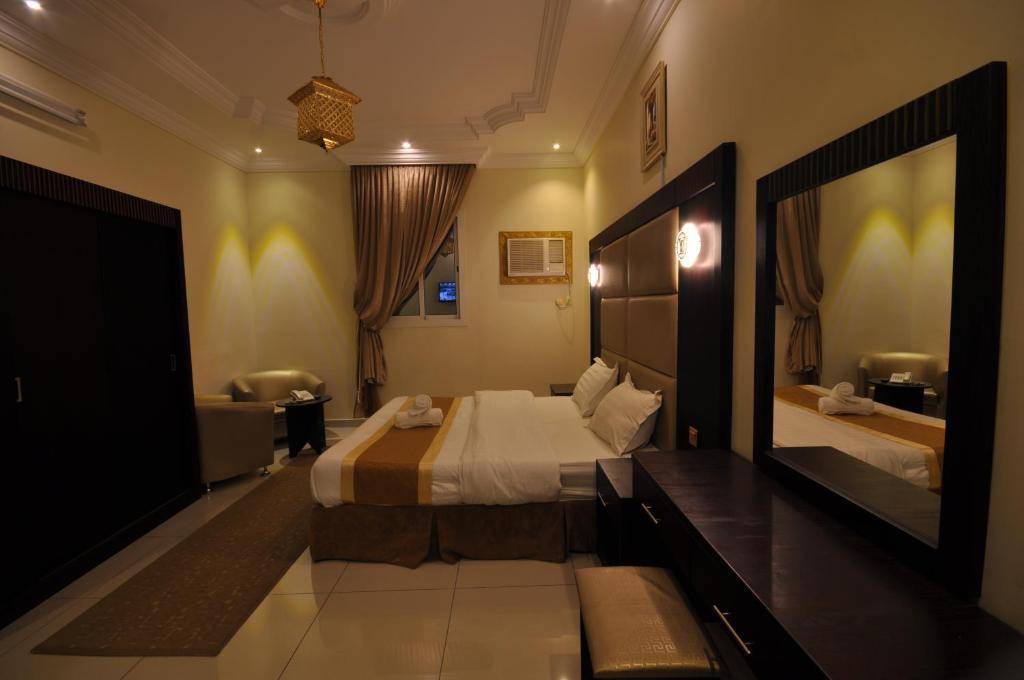 Cama ou camas em um quarto em Ritan Apart-Hotel