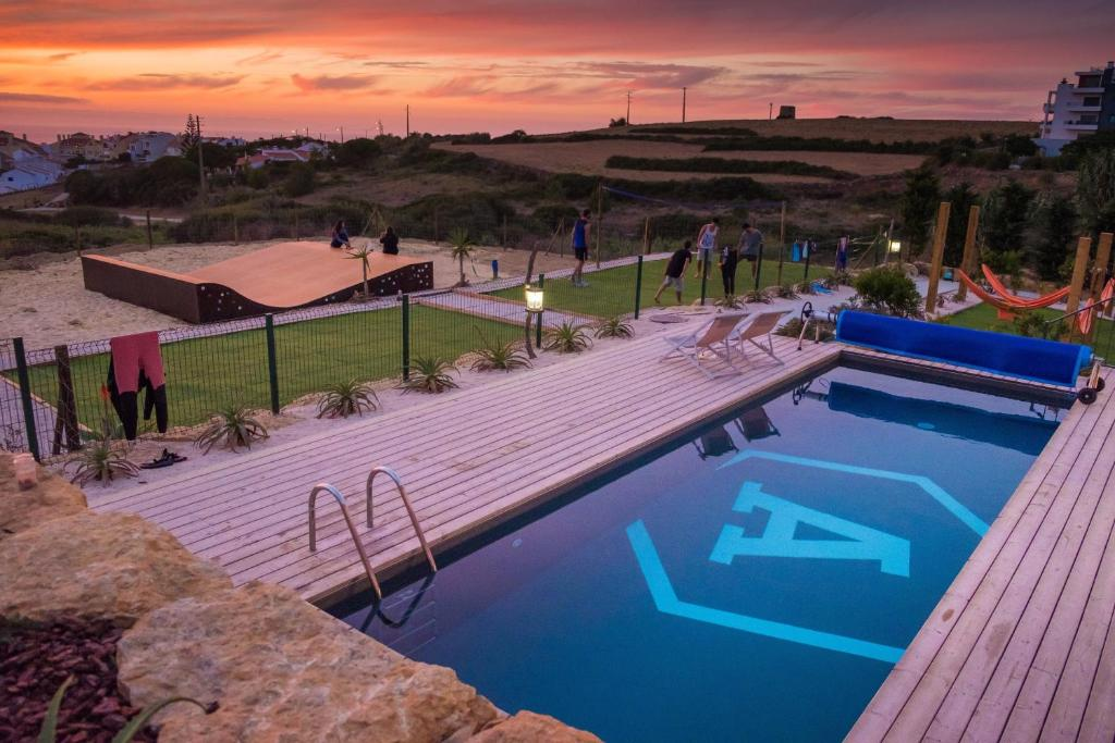 The swimming pool at or near Aktion Ericeira Surf Hostel
