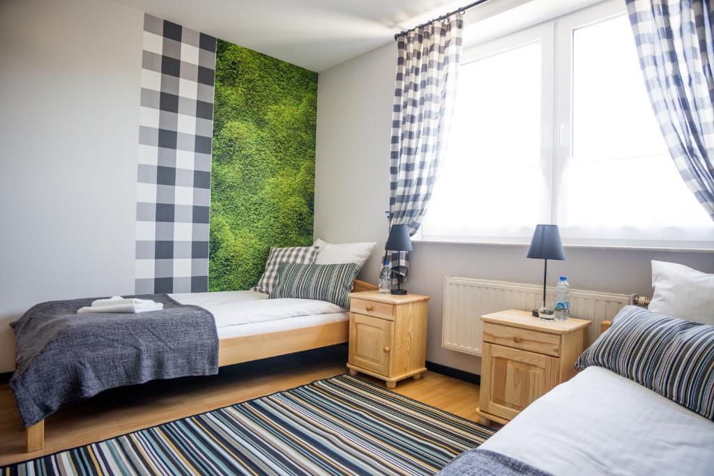 Łóżko lub łóżka w pokoju w obiekcie Stadnina koni Leśna Wola