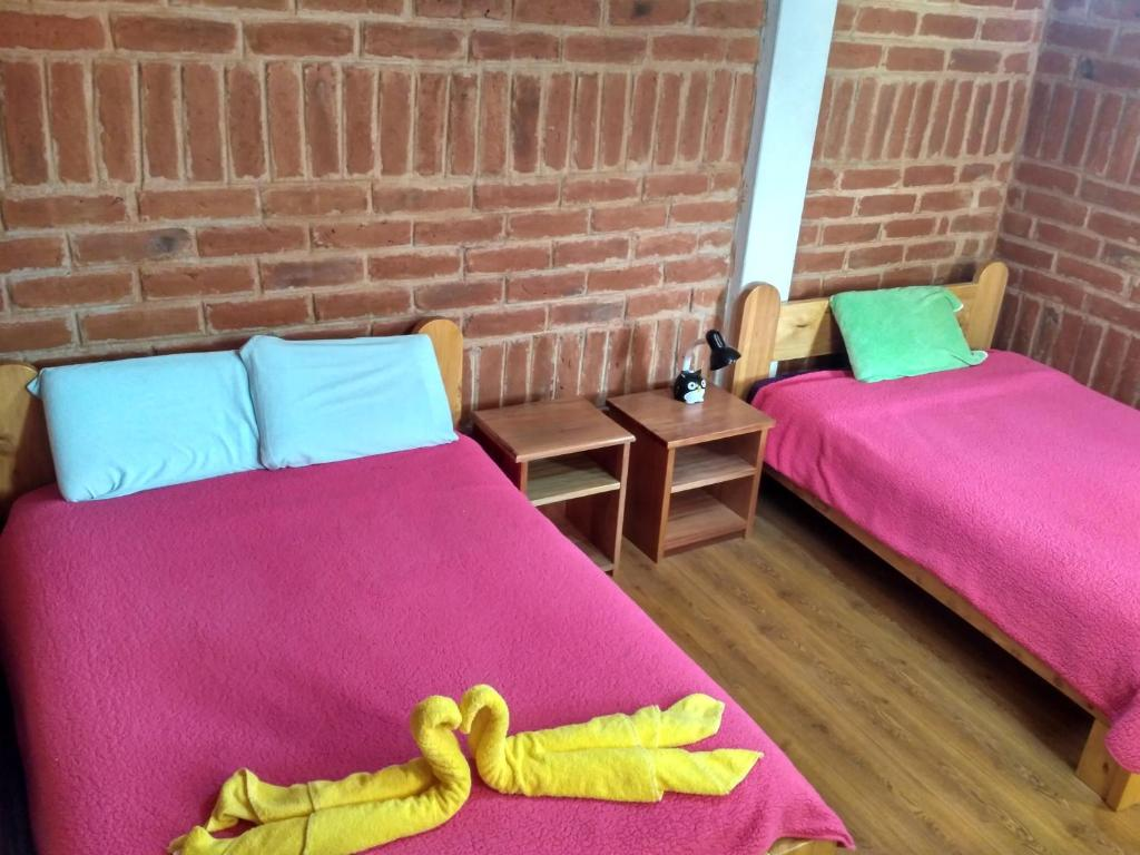 A bed or beds in a room at Hostal Cloud Forest