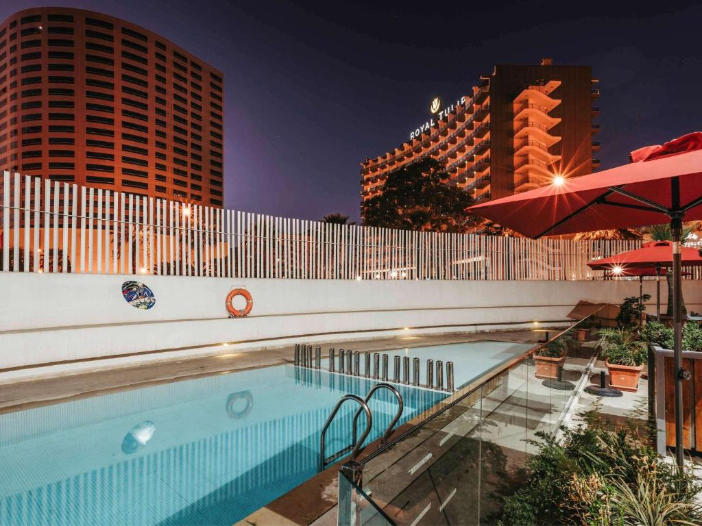 The swimming pool at or near Ibis Tanger City Center