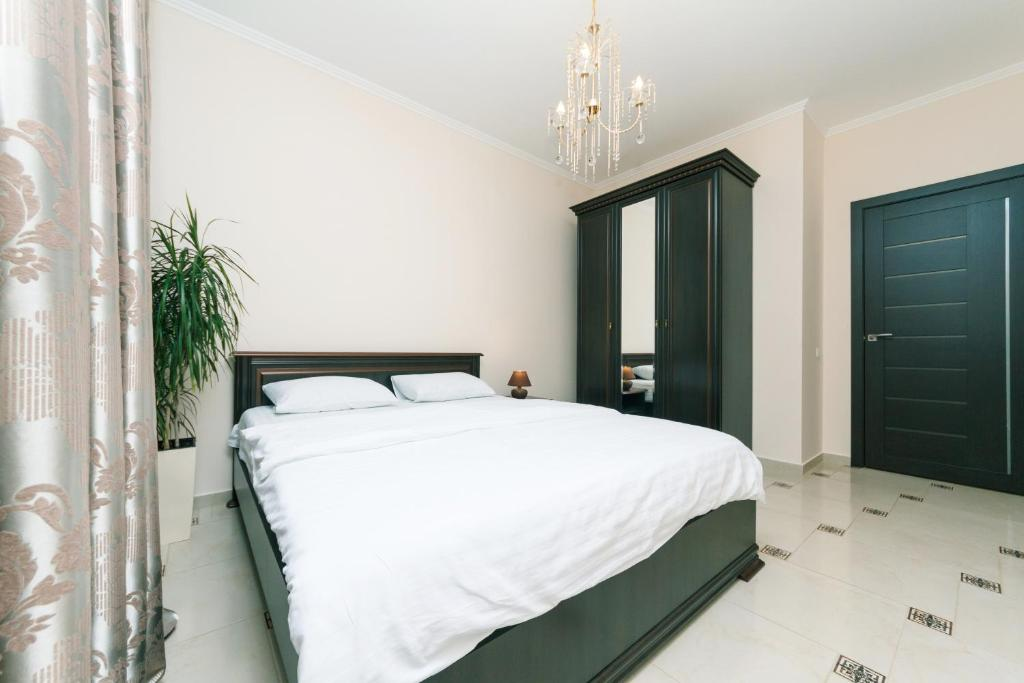 A bed or beds in a room at Lara Apartment