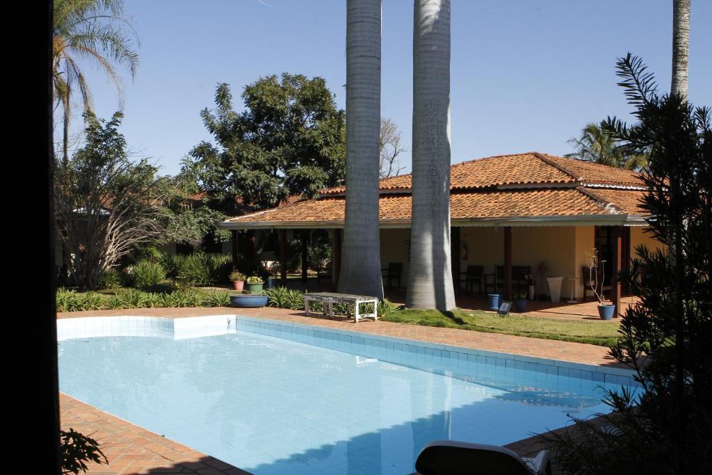 The swimming pool at or near Hotel Vila da Serra