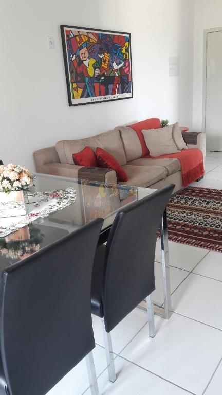 A seating area at Apartamento Criciúma