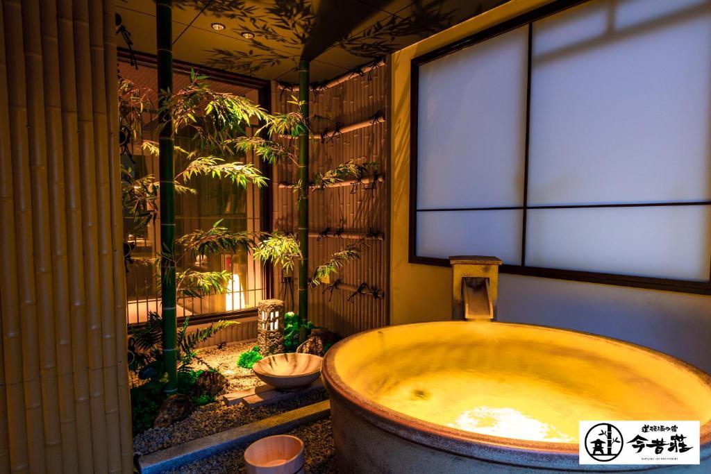 A bathroom at Konjaku-So Dotonbori Garden SPA Stay