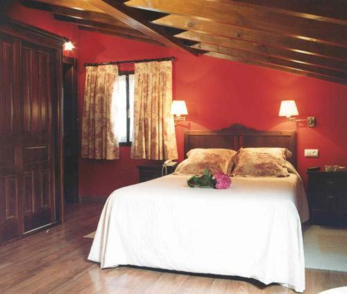 A bed or beds in a room at La Fonte