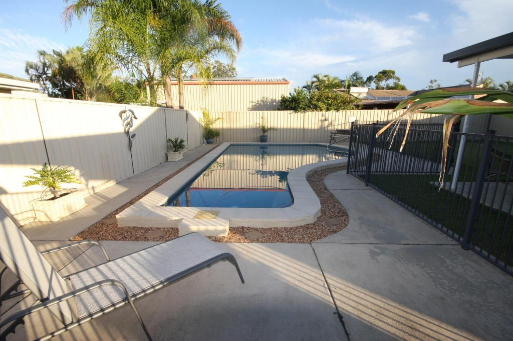 The swimming pool at or near 62 Tingira Close - Modern lowset home with swimming pool, outdoor area, ample parking. Pet friendly