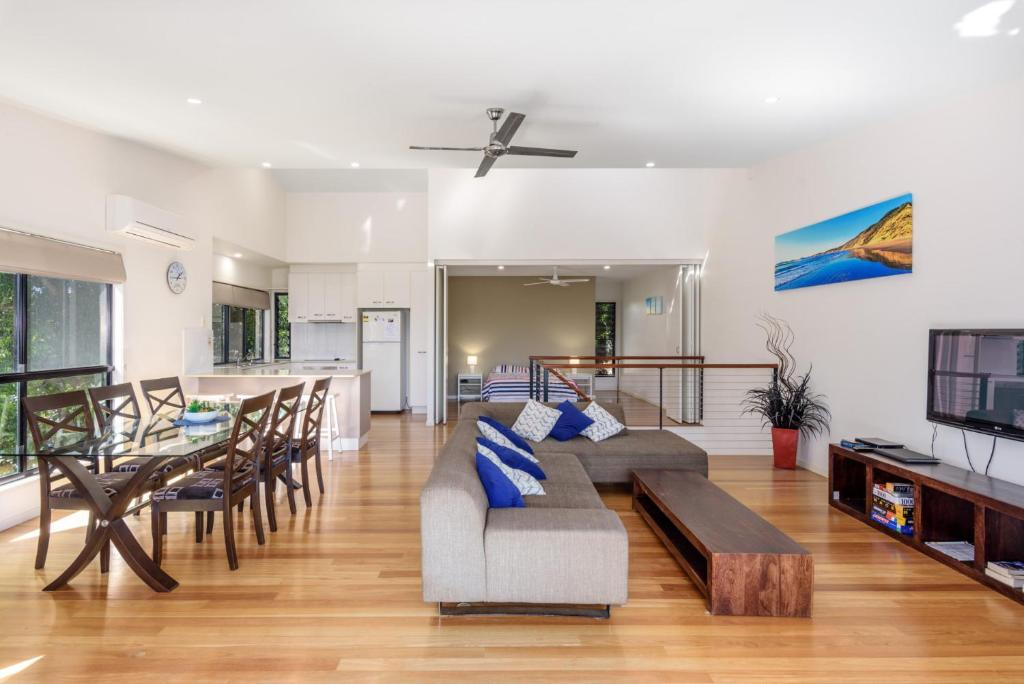 A seating area at Unit 1 Rainbow Surf - Modern, two storey townhouse with large shared pool, close to beach and shop