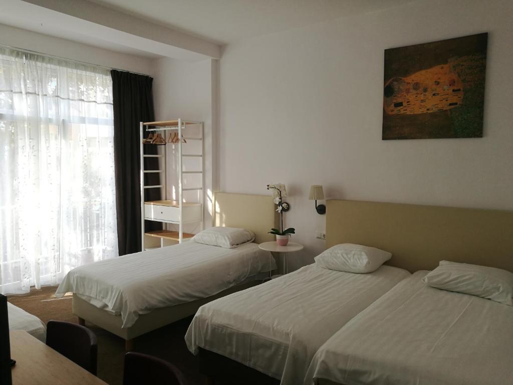 Un ou plusieurs lits dans un hébergement de l'établissement New City Hotel Scheveningen