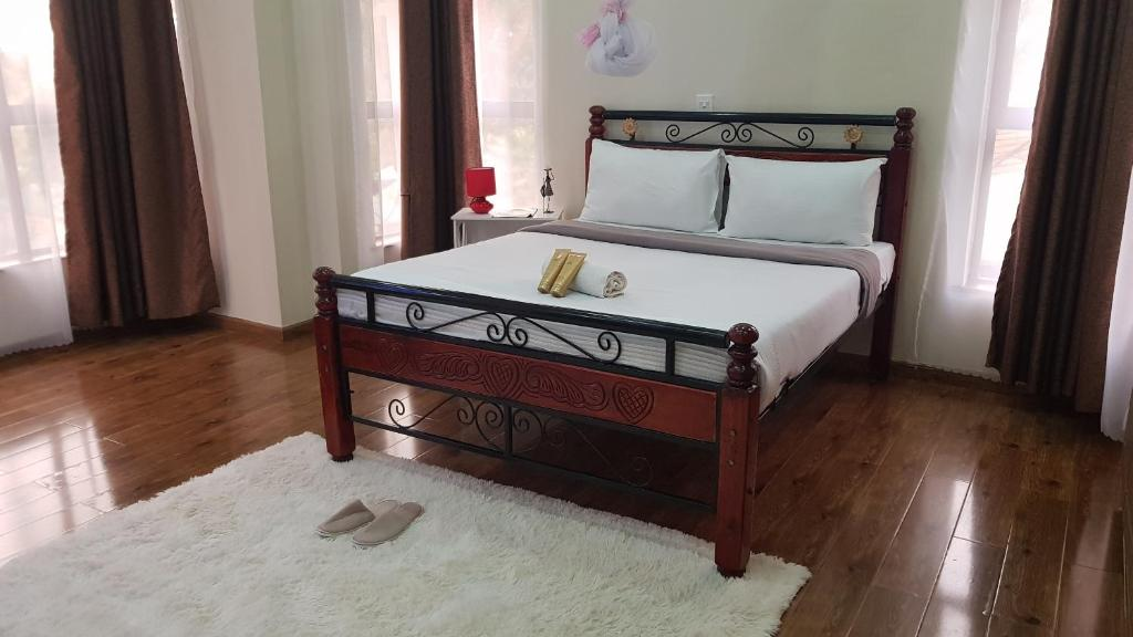 A bed or beds in a room at Kandiz Queendom
