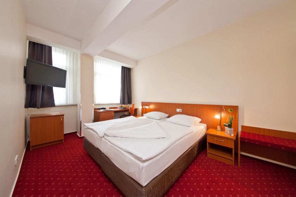Cama o camas de una habitación en Hotel Belmondo Hamburg Hbf