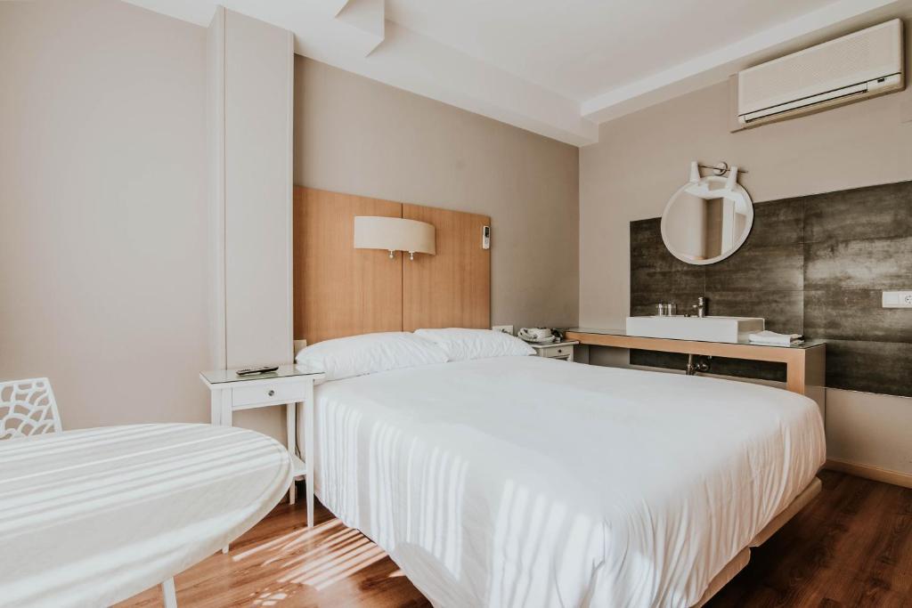 Cama o camas de una habitación en Hotel Isasa
