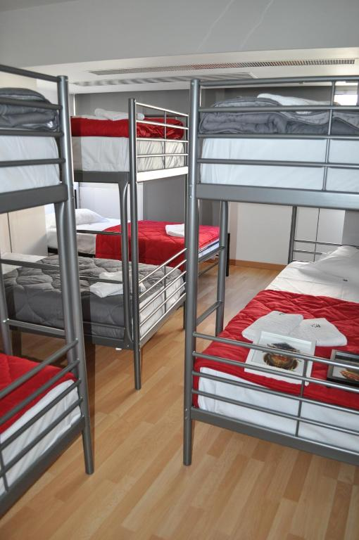 A bunk bed or bunk beds in a room at Corujinha Hostel