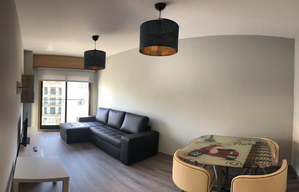 Zona de estar de Apartamentos Augusto
