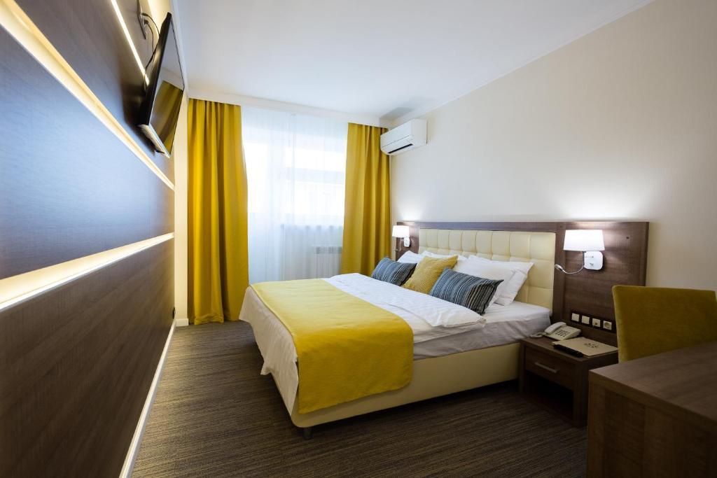 Кровать или кровати в номере Отель Луч