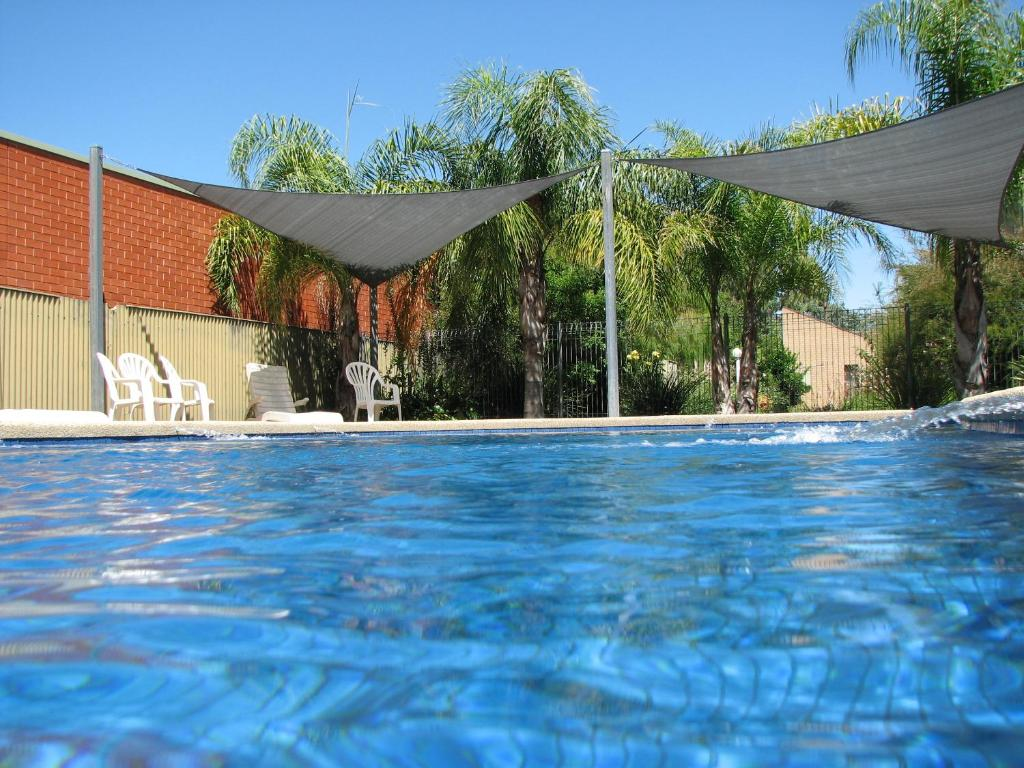 The swimming pool at or near Executive Hideaway