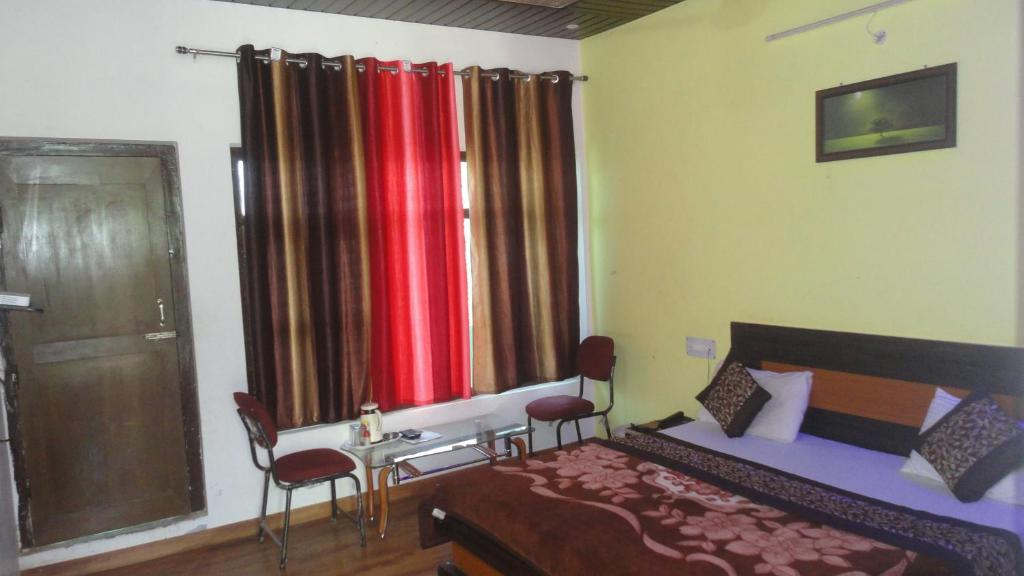 A bed or beds in a room at Hotel Deepraj