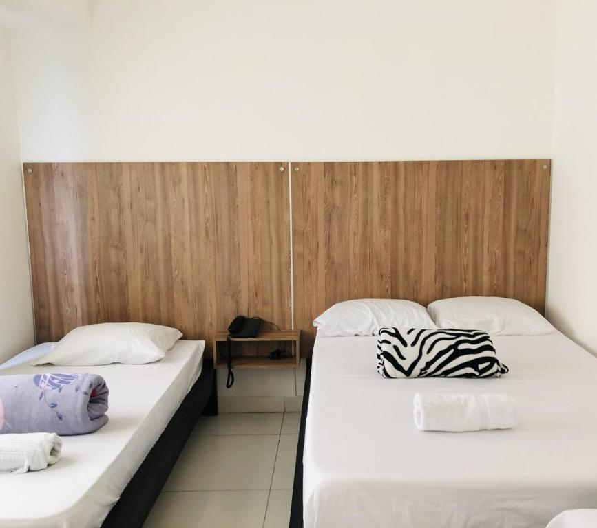 A bed or beds in a room at Hotel Center Plaza Plus