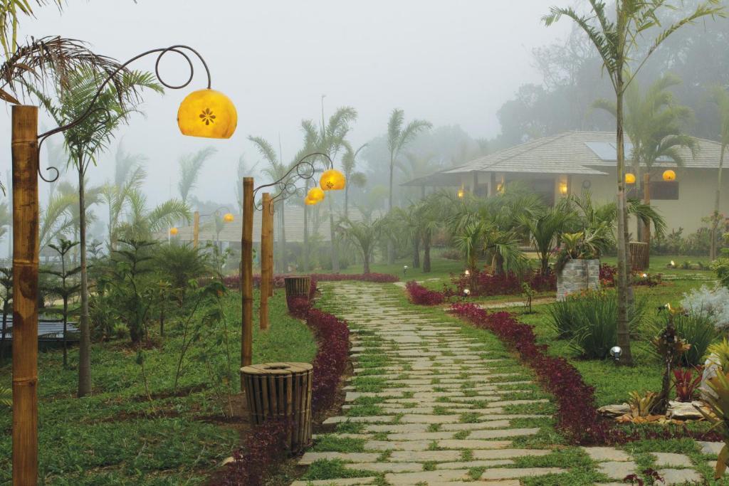 A garden outside Hotel Vale das Nuvens