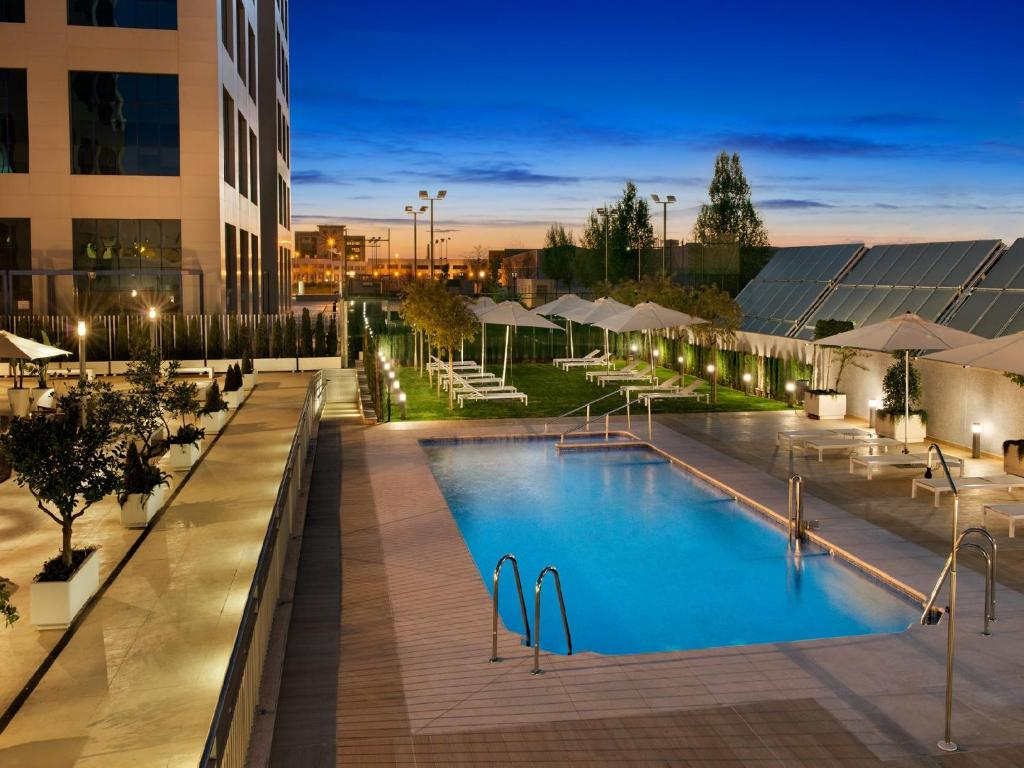 The swimming pool at or near Hilton Garden Inn Sevilla