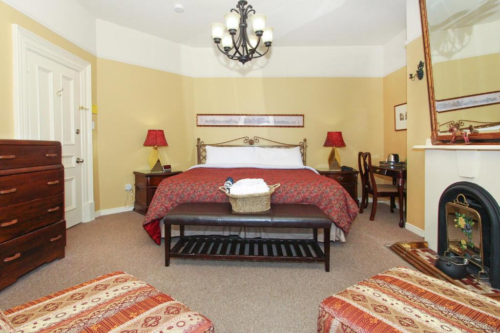 A bed or beds in a room at Abba Inn Guest House