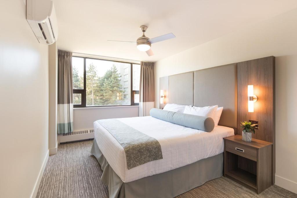 Ein Bett oder Betten in einem Zimmer der Unterkunft Gage Apartments at UBC