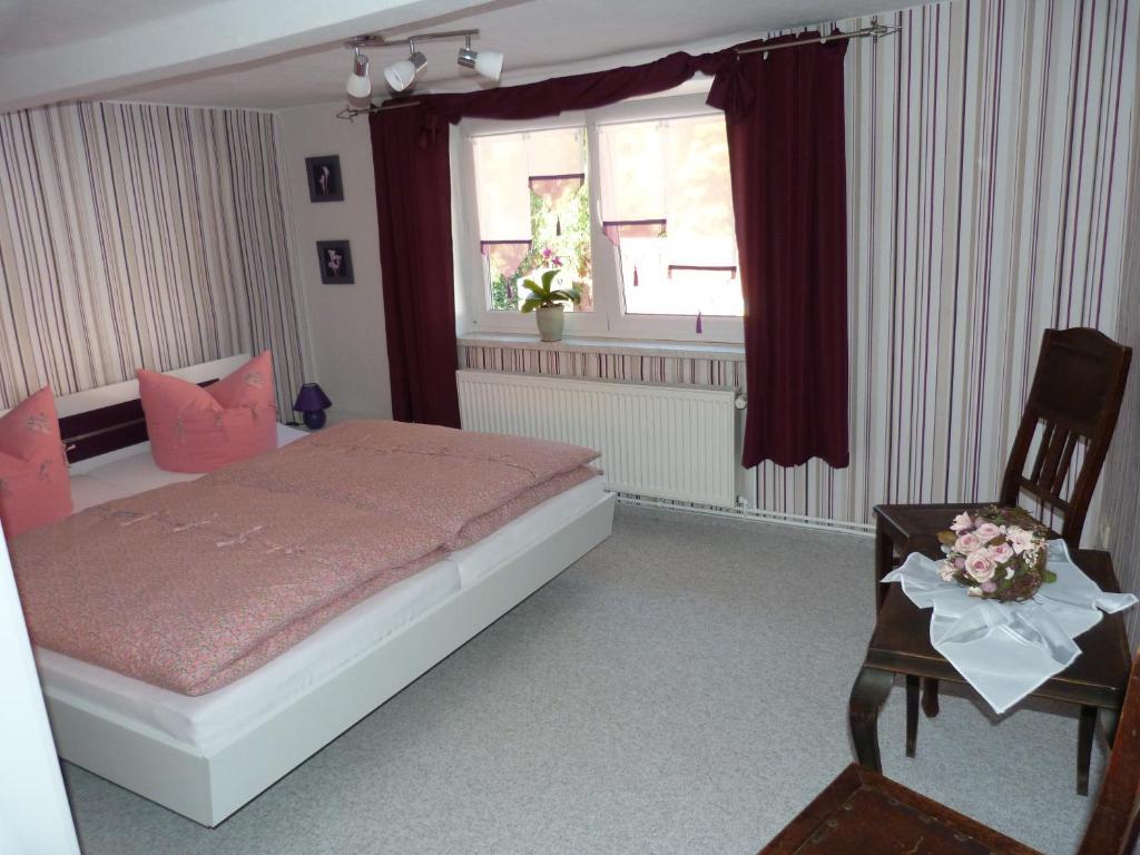 Ein Bett oder Betten in einem Zimmer der Unterkunft Ferienhaus Scheper