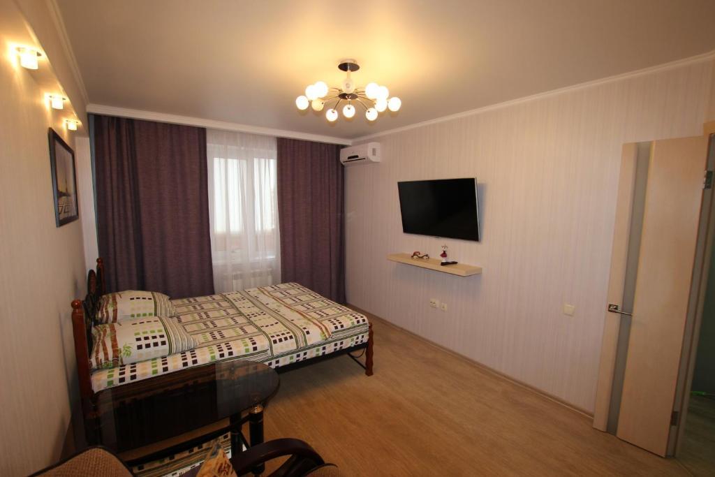 """Кровать или кровати в номере Apartments on Lenina 151 """"TatarHotel"""""""