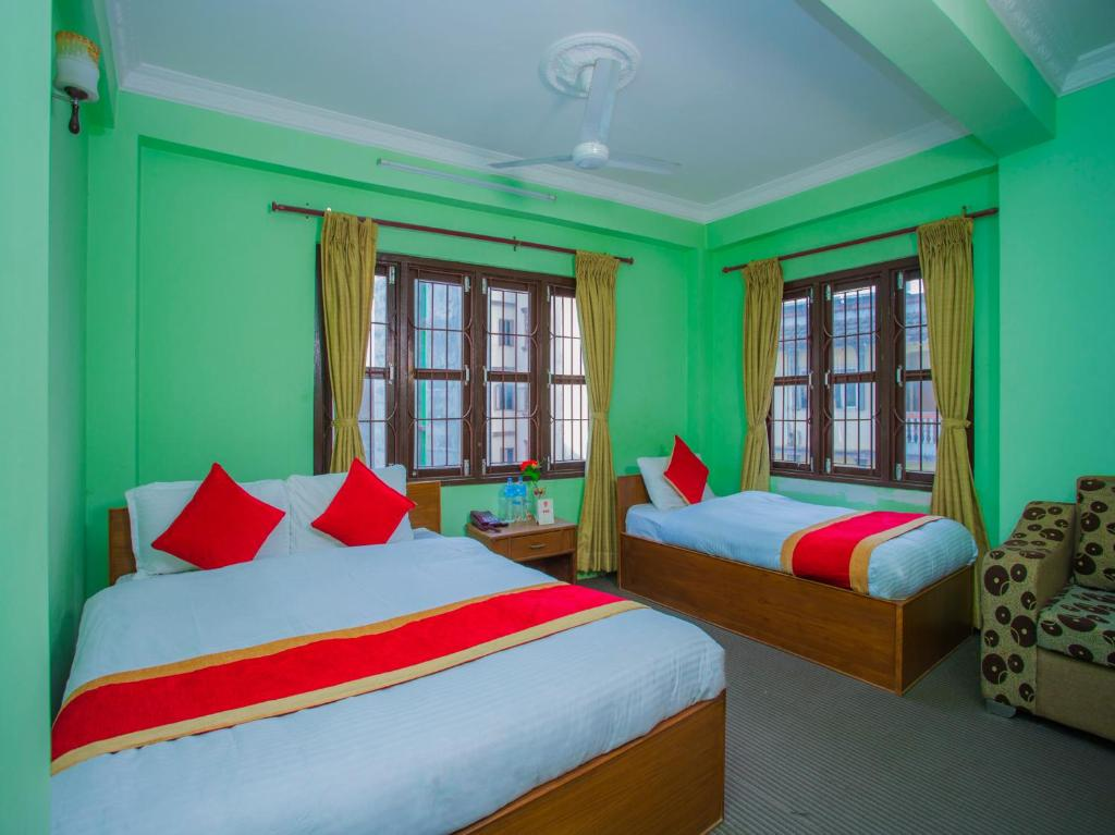 A bed or beds in a room at Waling Fulbari Guest House