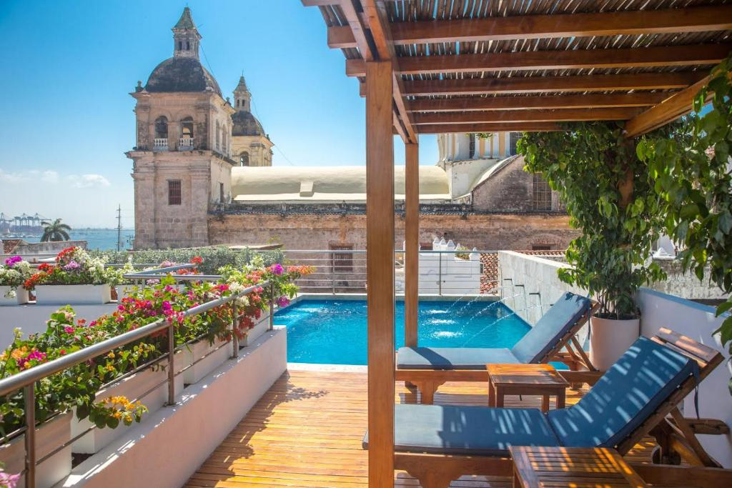 The swimming pool at or near Casa Claver Loft Boutique Hotel