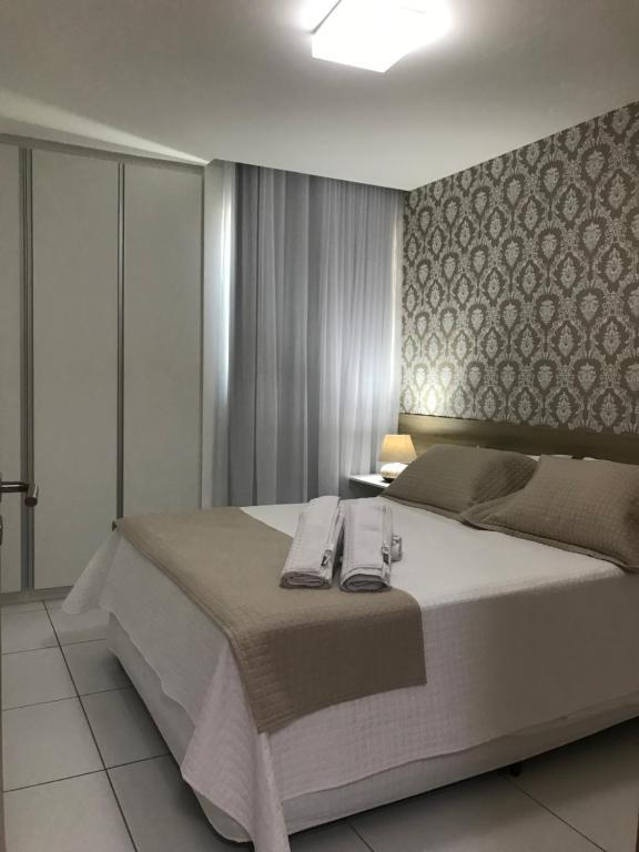 A bed or beds in a room at Apto ILOA na Barra de São Miguel