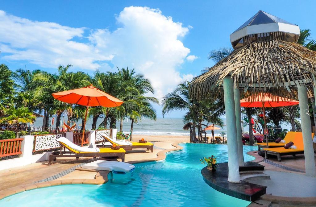 The swimming pool at or near Vartika Resovilla Kuiburi Beach Resort and Villas
