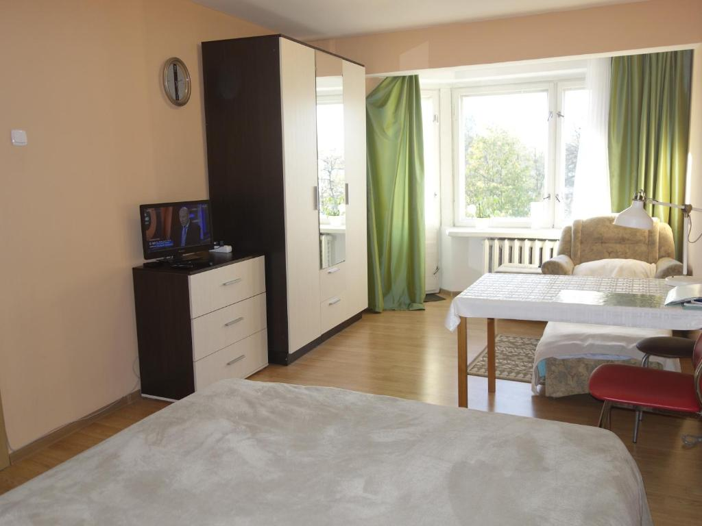 A bed or beds in a room at Apartment on Nikolskaya