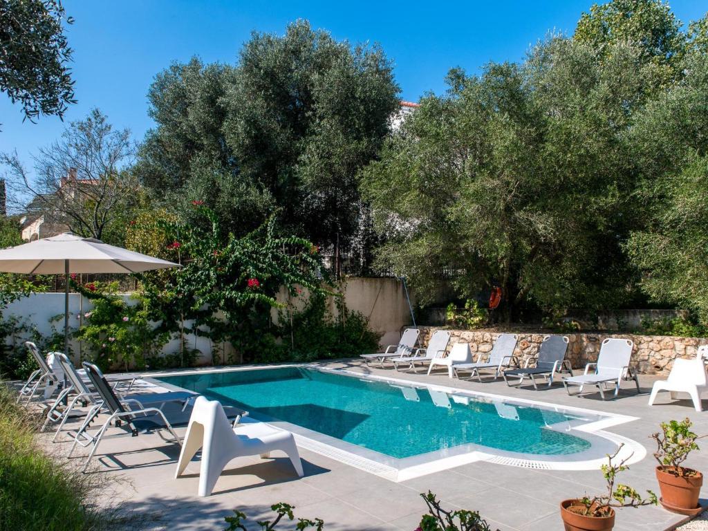 The swimming pool at or near Koxyli Studios & Apartments