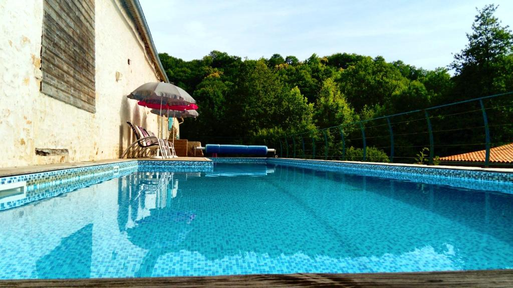 The swimming pool at or near Domaine Moulin la Place