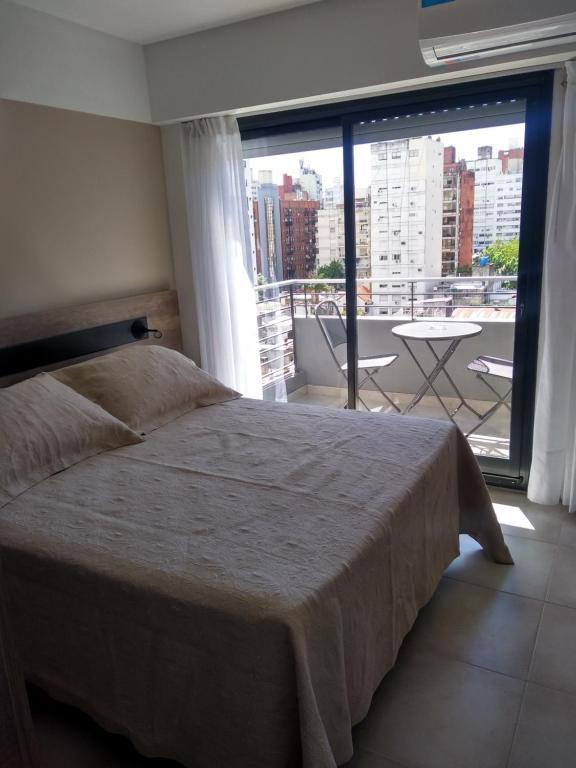 Una cama o camas en una habitación de Altos de Barrio Martin
